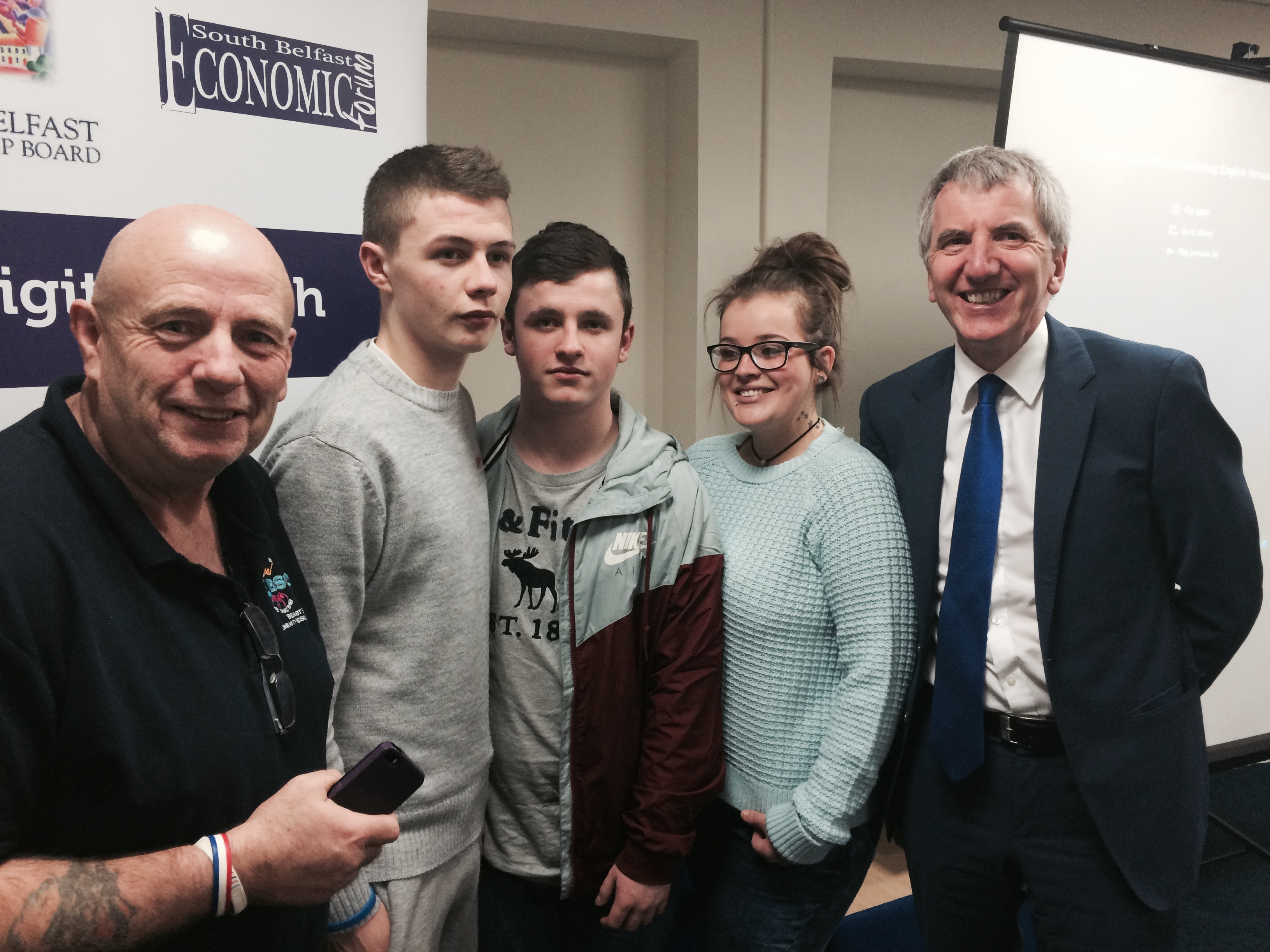Talented young film-makers Ceejay, Dillon and Natasha with Sandy Row community leader Garnet Busby