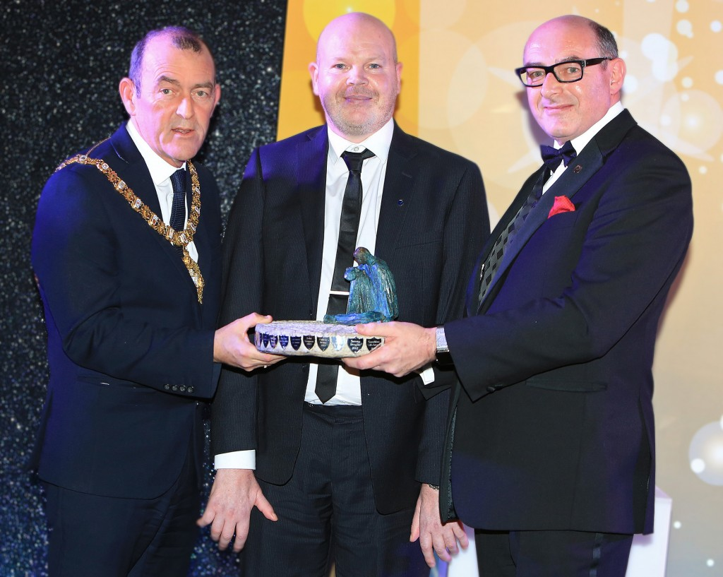 PERSON OF THE YEAR: Anto Finnegan becomes the 19th recipient of the Aisling Person of the Year statuette ('Wheel of Life' by Cliodhna Cussen). His accolade was presented by Belfast Mayor Arder Carson and John D'Arcy, National Director of Open University Ireland, premier business sponsors of the Aisling Awards