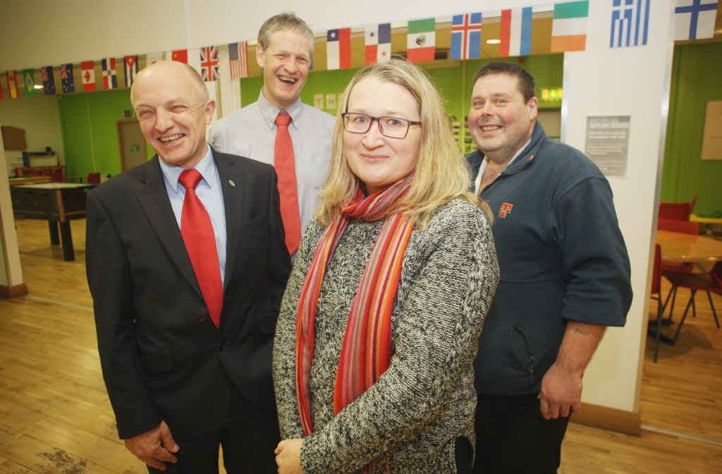 Andrew from the Presbyterian International Meeting Point (right) welcomes Chief Commissioner of the Equality Commission Michael Wardlow, Alliance Party representative Duncan Morrow and  Barbara Snowarska of the Polish Cultural Centre to the group's premises.