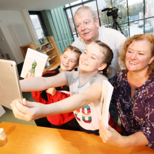 Cultœrlann McAdam î Fiaich, Nollaig î Gadhra Book launch, 'Cuimhn' Cairde'. pictured: M‡ir'n N' Ghadhra with her husband SŽamus and daughters Eimear and Ailbhe 2110JC17