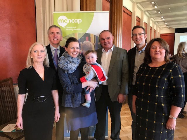 Mencap Director Margaret Kelly (left) told a symposium at Stormont last week of ambitious plans to provide additional support to children with intellectual disabilities. Kicking off proceedings was Sinn Féin MLA Michael Boyle (right). Also pictured is panelist Naomi McMullan and son Joseph.
