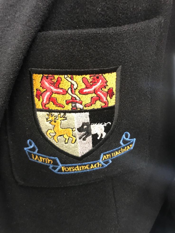 Sullivan Shield: In an older spelling is the Sullivan Upper motto,'Lámh Fhoistineach in Uachtar'