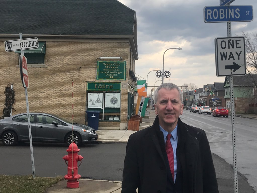 BOTH SIDES NOW: Bilingual street names may cause a flap in Belfast but in Buffalo's Irish Heritage District they are seen as a boon. Outside the city's magnificent Irish Centre, Sráid Roibín complements Robins Street
