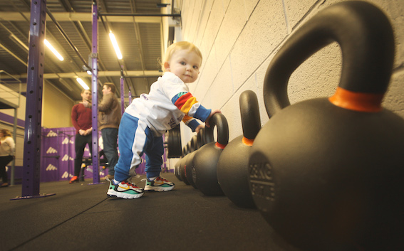A LONG WEIGHT: A defining aspect of the newly-returned Assembly is the youthfulness of the members. Not just as young as little Finn Doherty who was testing the weights at the McAufield Gym which opened in the Belfast Media Group print hall today but you get the picture!
